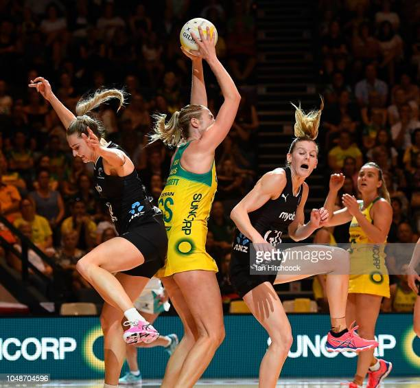 Caitlin Bassett of the Diamonds catches the ball between Jane Watson and Katrina Grant of the Silver Ferns during the Constellation Cup match between...