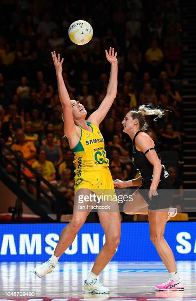 Caitlin Bassett of the Diamonds catches the ball over Jane Watson of the Silver Ferns during the Constellation Cup match between the Australian...