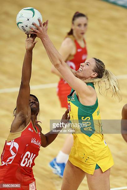 Caitlin Bassett of the Diamonds competes for the ball with Ama Agbeze of the Roses during the International Test match between the Australian...