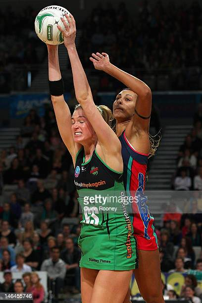 Caitlin Bassett of the Fever catches the ball infront of Geva Mentor of the Vixens during the round 12 ANZ Championship match between the Melbourne...