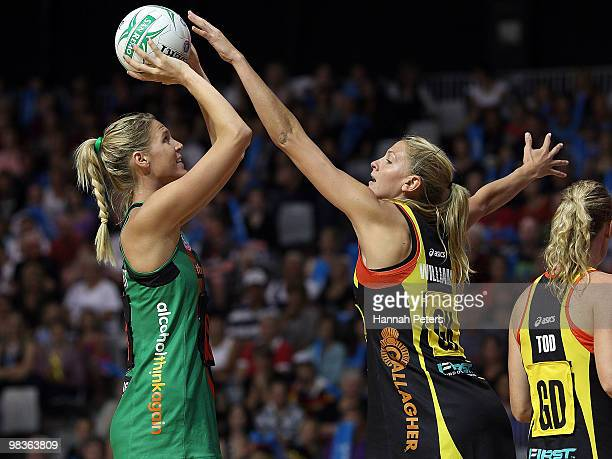 Caitlin Bassett of the Fever shoots as Casey Williams of the Magic defends during the round four ANZ Championship match between the Waikato Bay of...