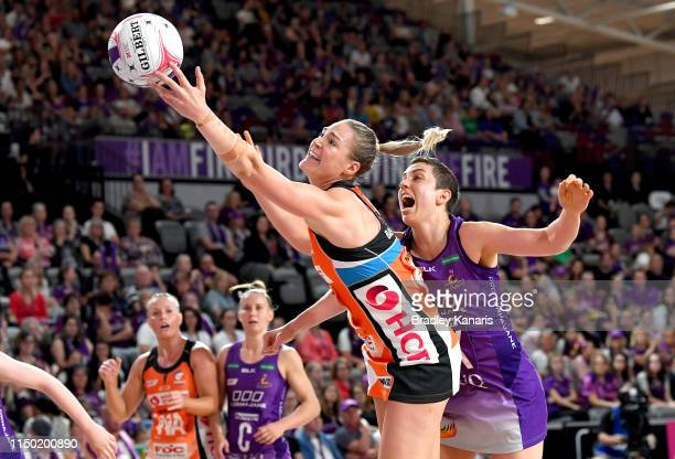 Caitlin Bassett of the Giants and Laura Clemesha of the Firebirds challenge for the ball during the round 4 Super Netball match between the Firebirds...