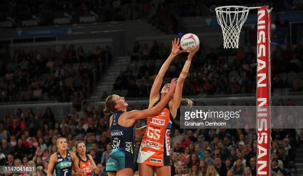 Caitlin Bassett of the Giants jumps for the ball during the round two Super Netball match between the Melbourne Vixens and the Giants at Melbourne...