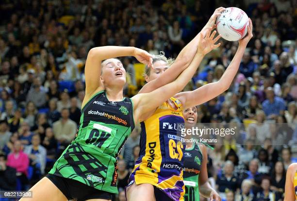 Caitlin Bassett of the Lightning and Courtney Bruce of the Fever challenge for the ball during the round 12 Super Netball match between the Lightning...