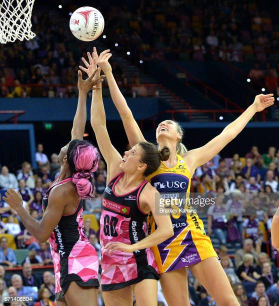Caitlin Bassett of the Lightning and Fiona Themann of the Thunderbirds compete for the ball during the round nine Super Netball match between the...