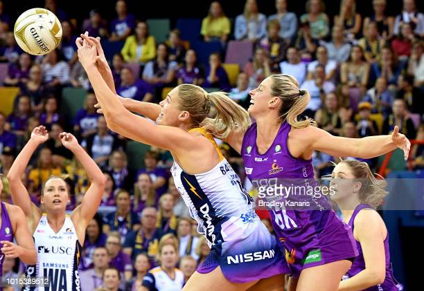 Caitlin Bassett of the Lightning and Laura Geitz of the Firebirds challenge for the ball during the Super Netball Major Semi Final match between the...