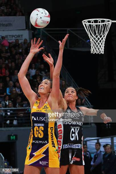 Caitlin Bassett of the Lightning and Sharni Layton of the Magpies compete for the ball during the round 11 Super Netball match between the Magpies...