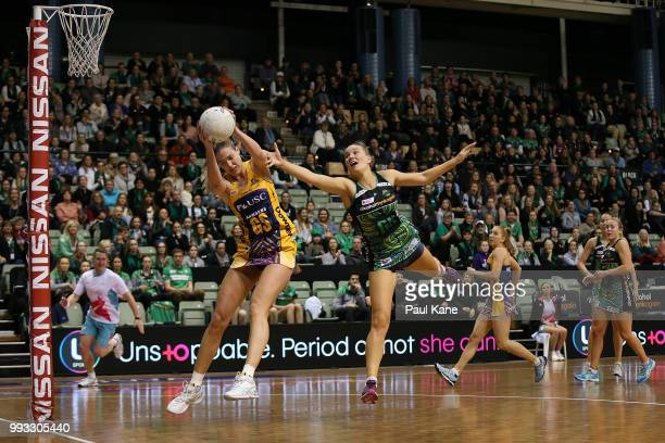 Caitlin Bassett of the Lightning catches a pass against Courtney Bruce of the Fever during the round 10 Super Netball match between the Fever and the...