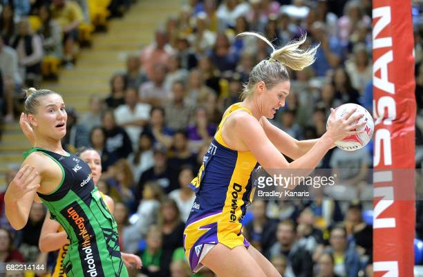 Caitlin Bassett of the Lightning catches the ball during the round 12 Super Netball match between the Lightning and the Fever at University of the...
