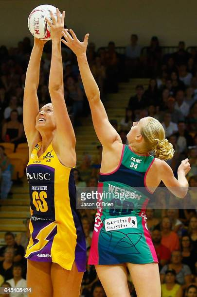 Caitlin Bassett of the Lightning in action with Chloe Watson of the Vixens during the round two Super Netball match between the Queensland Firebirds...