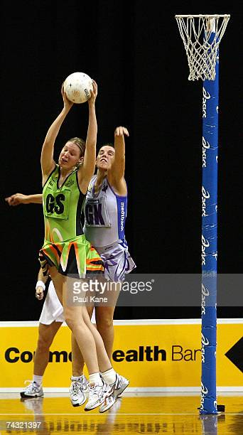Caitlin Bassett of the Orioles receives the ball in front of Bianca Reddy of the Thunderbirds during the week five Commonwealth Bank Trophy match...