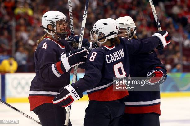 Caitlin Cahow of the United States celebrates scoring with teammates Angela Ruggiero and Karen Thatcher during the ice hockey women's semifinal game...