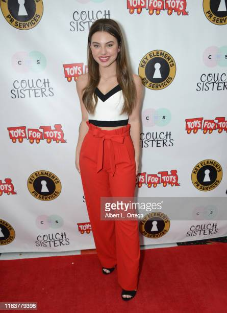 Caitlin Carmichael attends The Couch Sisters 1st Annual Toys For Tots Toy Drive held onNovember 20 2019 in Glendale California