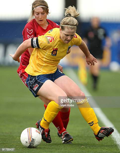 Caitlin Cooper of the Mariners and Marijana Rajcic of the United compete for the ball during the round two WLeague match between the Central Coast...