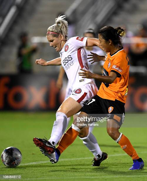 Caitlin Cooper of the Wanderers and Yuki Nagasato of the Roar compete for the ball during the round eight WLeague match between the Brisbane Roar and...