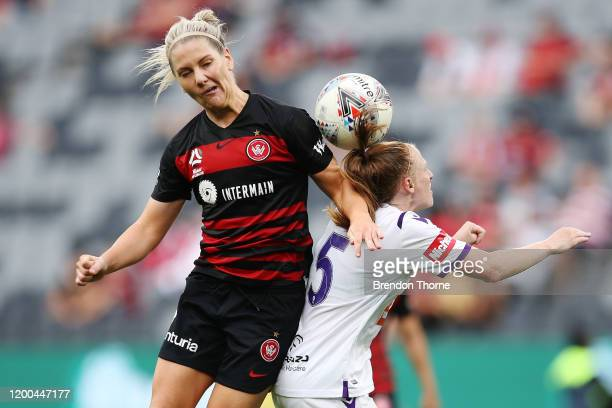 Caitlin Cooper of the Wanderers competes with Shannon May of the Glory during the round 10 W-League match between the Western Sydney Wanderers and...