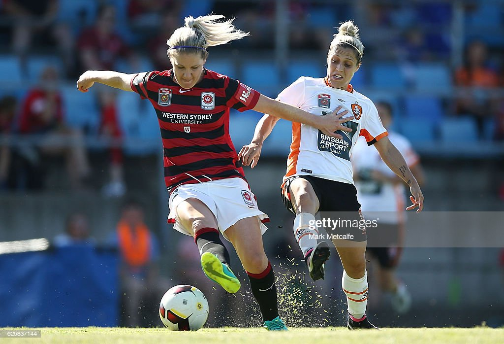 Caitlin Cooper of the Wanderers is challenged by Katrina Goryy of the Roar during the round four W-League match between the Western Sydney Wanderers and the Brisbane Roar at Marconi Stadium on November 26, 2016 in Sydney, Australia.