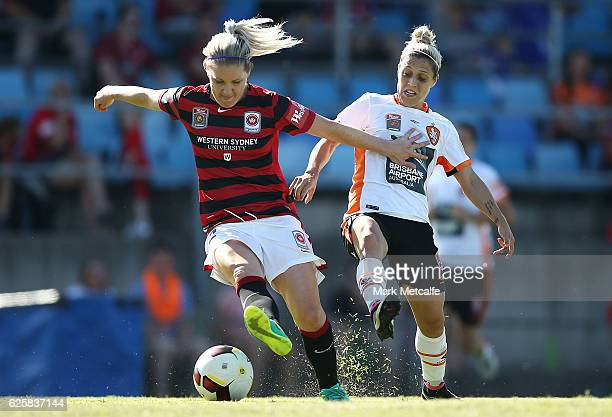 Caitlin Cooper of the Wanderers is challenged by Katrina Goryy of the Roar during the round four WLeague match between the Western Sydney Wanderers...