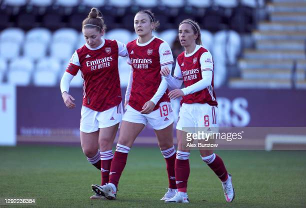Caitlin Foord of Arsenal celebrates with Kim Little and Jordan Nobbs after scoring their team's second goal during the Barclays FA Women's Super...