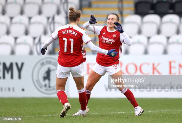 Caitlin Foord of Arsenal celebrates with team mate Vivianne Miedema after scoring their side's first goal during the Barclays FA Women's Super League...