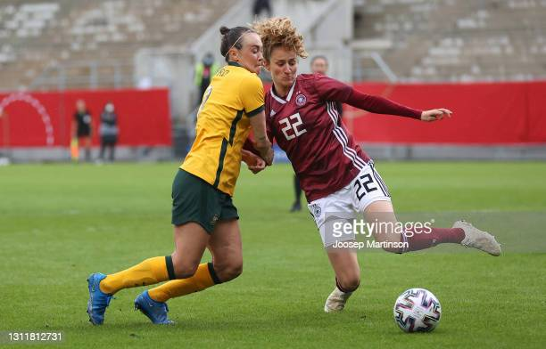 Caitlin Foord of Australia and Fabienne Dongus of Germany battle for the ball during the Women's International Friendly match between Germany and...