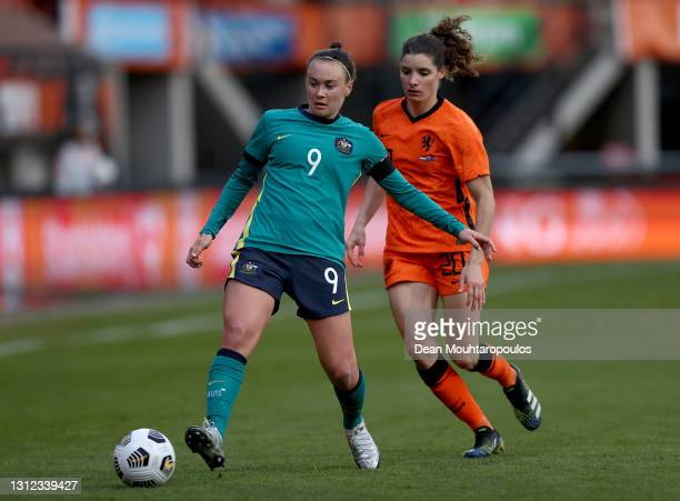 Caitlin Foord of Australia battles for possession with Dominique Janssen of Netherlands during the International Friendly match between Netherlands...