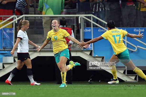 Caitlin Foord of Australia celebrates scoring a goal during the first half against Germany in the Women's First Round Group F match at Arena...