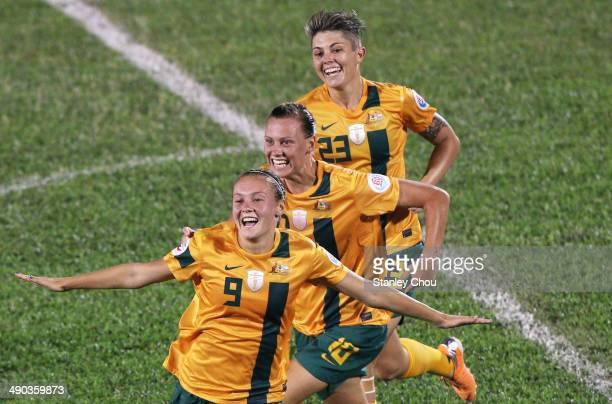 Caitlin Foord of Australia celebrates with her teammates after scoring against Japan during the AFC Women's Asian Cup Group B match between Australia...