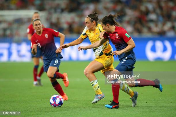 Caitlin Foord of Australia holds off the challenge from Ingrid Moe Wold of Norway during the 2019 FIFA Women's World Cup France Round of 16 match...