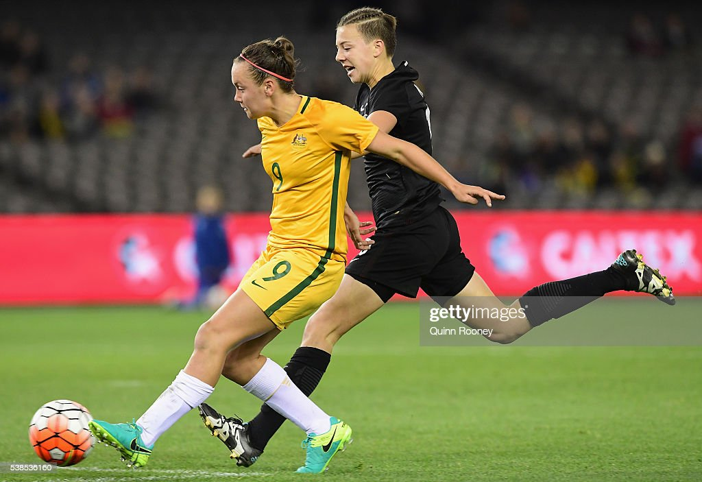 Caitlin Foord of Australia passes infront of Meikayla Moore of New Zealand during the Women's International Friendly match between the Australia Matildas and the New Zealand Football Ferns at Etihad Stadium on June 7, 2016 in Melbourne, Australia.