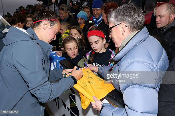 Caitlin Foord of Australia signs autographs for fans after the women's international friendly match between the Australian Matildas and the New...