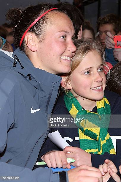 Caitlin Foord of Australia takes a photo with a fan after the women's international friendly match between the Australian Matildas and the New...