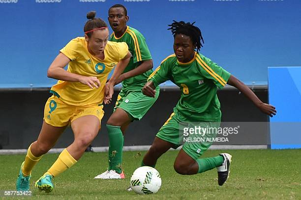 Caitlin Foord of Australia vies for the ball with Rejoice Kapfumvuti of Zimbabwe during their Rio 2016 Olympic Games womens first round Group F...