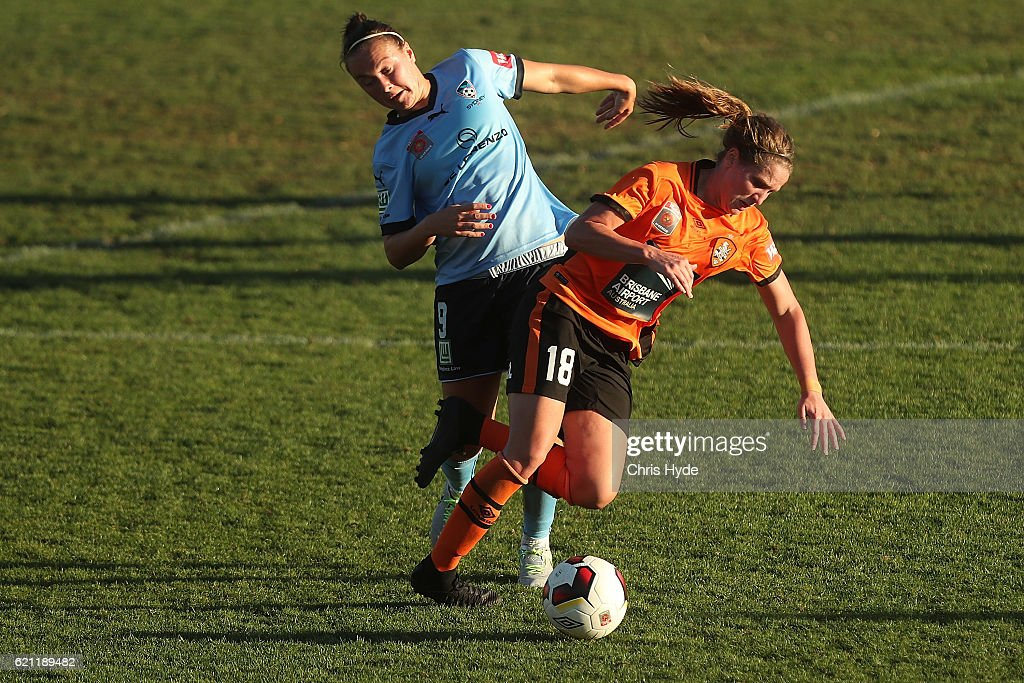 Caitlin Foord of Sydney FC and Madlyn Evans of the Roar compete for the ball during the round one W-League match between the Brisbane Roar and Sydney FC at Spencer Park on November 5, 2016 in Brisbane, Australia.