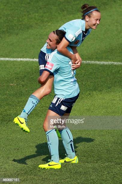 Caitlin Foord of Sydney is congratulated by team mate Emma Kete after scoring her third goal during the round seven WLeague match between Sydney FC...