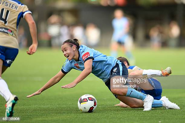 Caitlin Foord of Sydney is tackled by Jenna Kingsley of the Jets during the round 13 WLeague match between Sydney FC and the Newcastle Jets at...