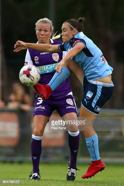 Caitlin Foord of Sydney traps the ball against Kim Carroll of the Perth Glory during the round 11 WLeague match between the Perth Glory and Sydney FC...