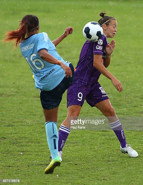 Caitlin Foord of the Glory challenges Samantha Johnson of Sydney during the round six WLeague match between the Perth Glory and Sydney FC at Ashfield...