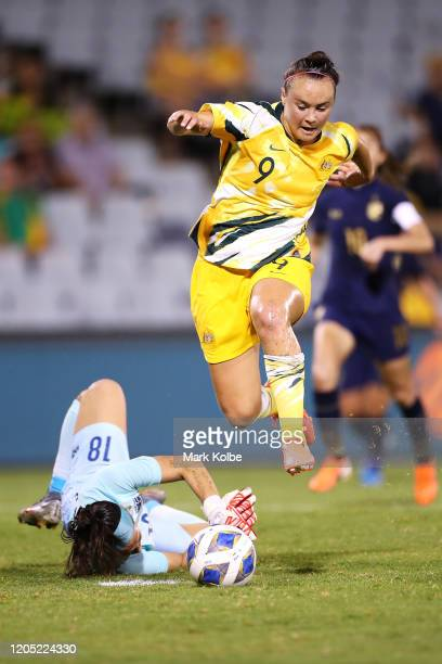 Caitlin Foord of the Matildas jumps over Thailand goalkeeper Tiffany Sornpao during the Women's Olympic Football Tournament Qualifier match between...