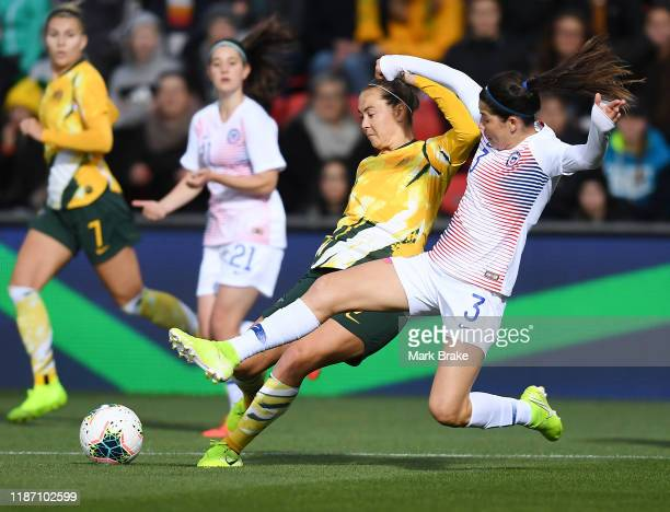 Caitlin Foord of the Matildas tackled by Carla Guerreo of Chile during the International friendly match between the Australian Matildas and Chile at...