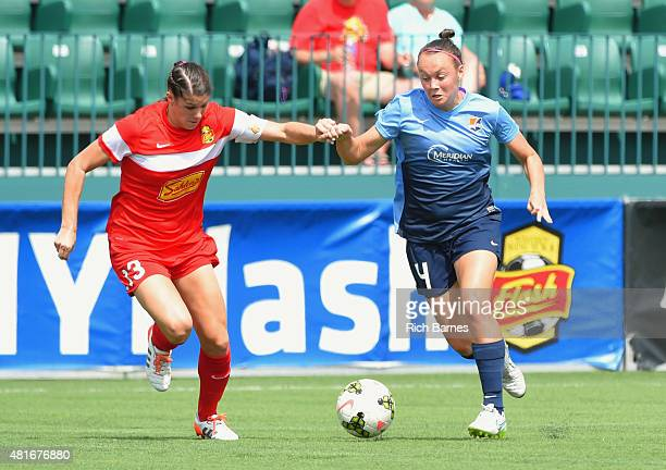 Caitlin Foord of the Sky Blue FC controls the ball against the defense of Brittany Taylor of the Western New York Flash during the first half at...