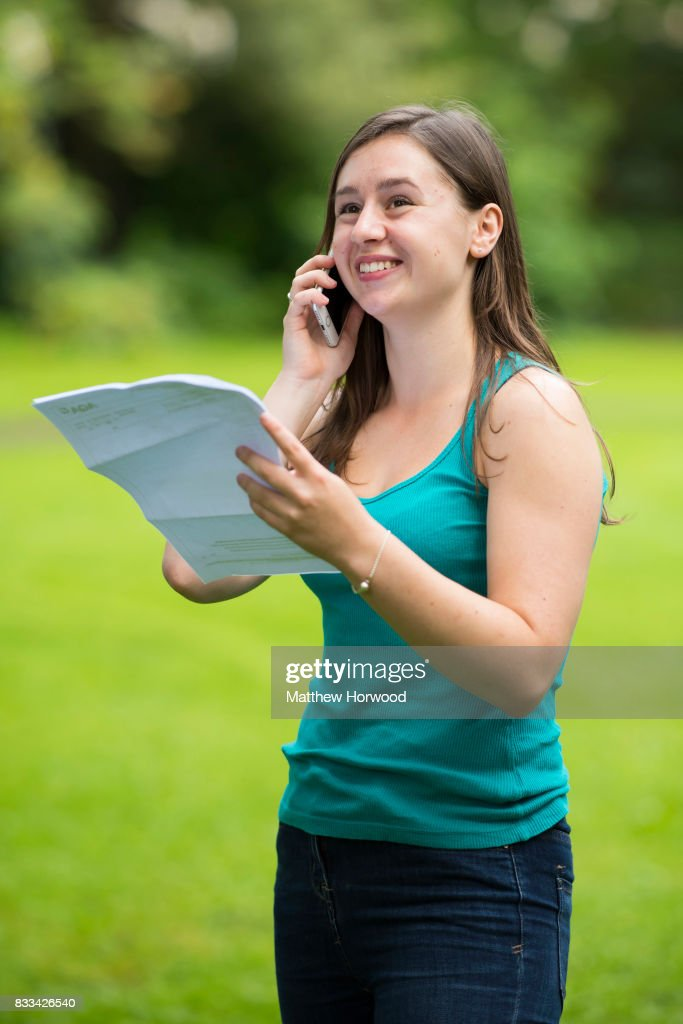 Caitlin Hannah speaks on the phone after receiving 2 As and an A* in her A Level results at Ffynone House School on August 17, 2017 in Swansea, Wales. There have been 416,000 university places confirmed - down 2% at the same point last year.