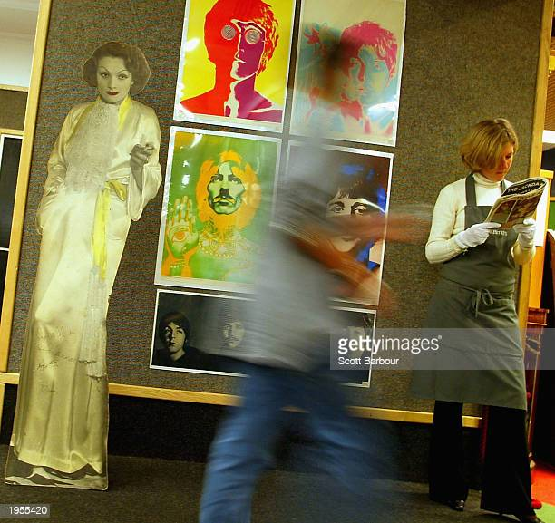 Caitlin Hazel from Christie's puts an autographed lifesize standee of Marlene Dietrich which was used in the famous crowd scene in Peter Blake's...