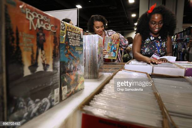 Caitlin Laurent of Rockville MD and Lauren McNeal of Silver Spring MD shop for comic books during the first day of Awesome Con at the Walter E...