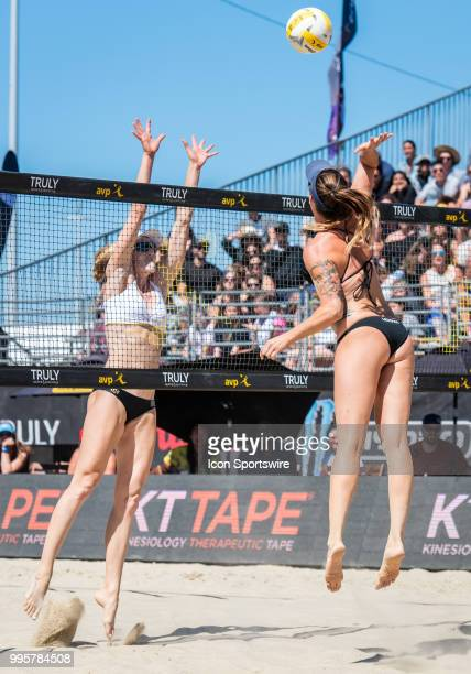 Caitlin Ledoux sends a kill over the block of Emily Day in the women's Finals of the AVP Pro Beach Volleyball Tour on Sunday July 8 2018 at Pier 32...