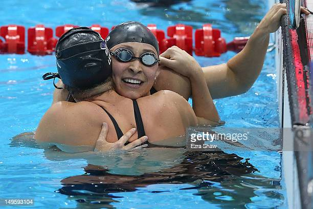 Caitlin Leverenz of the USA celebrates with teammate Ariana Kukors after winning bronze in the Women's 200m Individual Medley final on Day 4 of the...