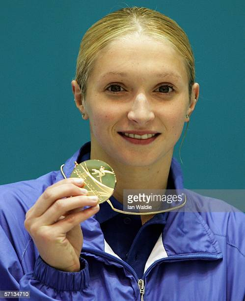 Caitlin McClatchey of Scotland poses with the gold medal after winning the women's 400m freestyle final at the swimming held at the Melbourne Sports...