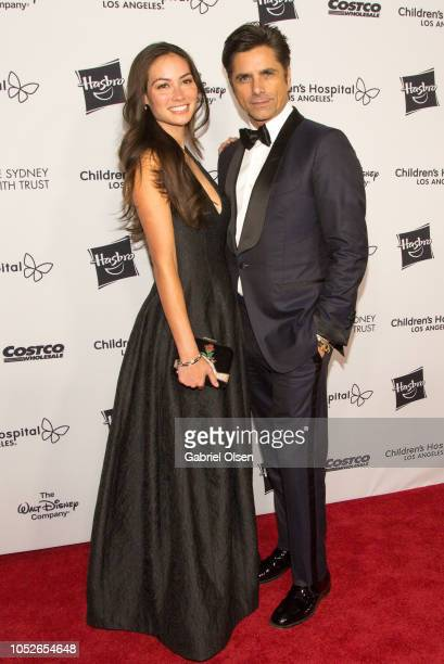 CTOBER 20 Caitlin McHugh and John Stamos arrive for 2018 From Paris with Love Children's Hospital Los Angeles Gala at LA Live Event Deck on October...