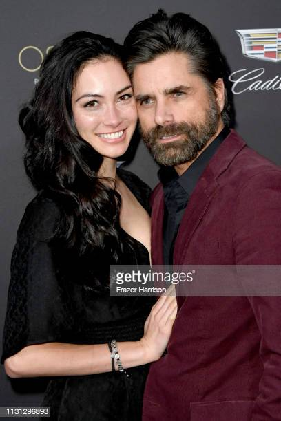 Caitlin McHugh and John Stamos attend the Cadillac celebrates The 91st Annual Academy Awards at Chateau Marmont on February 21 2019 in Los Angeles...