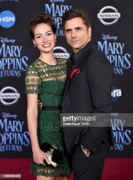 Caitlin Mchugh and John Stamos attend the premiere of Disney's 'Mary Poppins Returns' at El Capitan Theatre on November 29 2018 in Los Angeles...